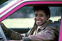 Woman smiles while driving.jpg