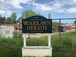 """Welcome to Woodlawn Heights"" sign."