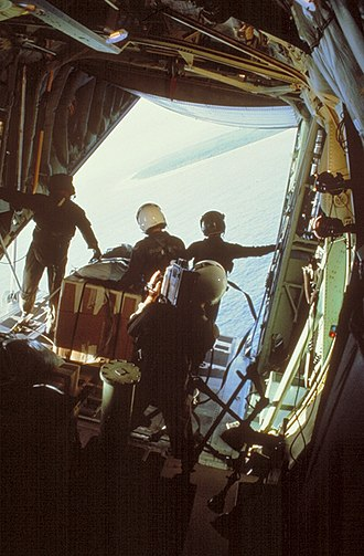 Operation Christmas Drop - WC-130 of the 54th Weather Reconnaissance Squadron out of Guam, circles around for the airdrop in 1986.