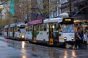 Swanston Street, Melbourne - A pair of southbound Melbourne trams embark passengers in Swanston Street just north of Little Collins Street, May 2012.