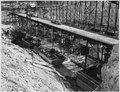 """""""Power house concrete blocks on west side, shown under the lower placing trestle."""" - NARA - 294299.tif"""