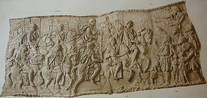 Equites singulares Augusti - Imperial horseguards (left) escort the emperor Trajan (centre right) on campaign in Dacia (AD 101-5). Detail from Trajan's Column, Rome