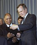 1993-Jan-12-Bush-Library-P39091-04A-Roland-Johnson-ADA-Award.jpg