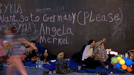 By opening Germany's borders to immigrants and refugees, primarily from the Middle East and Africa, many critics have blamed Merkel for encouraging the mass migration into Europe. 2015.09.02.-Menekultek-a-Keletinel-01.jpg