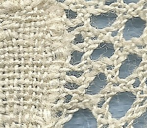 Mesh grounded bobbin lace