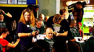 St. Baldrick's Foundation - Women shaving their head at the 46 mommas program which is a fundraising initiative by St. Baldrick's