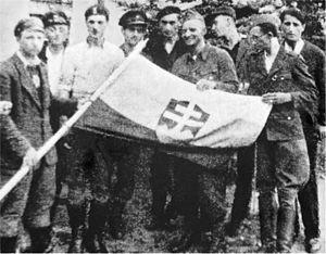 "Mirosław Iringh - The ""Slovak Platoon"" in 1944 (photo by Maria Budzanowska). Note the Slovak flag and armbands."
