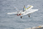 A U.S. Navy F-A-18C Hornet aircraft assigned to Strike Fighter Squadron (VFA) 146 launches from the aircraft carrier USS Nimitz (CVN 68)Aug. 20, 2013, while underway in the Gulf of Oman 130820-N-TI017-122.jpg