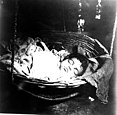A baby sleeping after being given a dose of opium.jpg