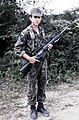 A fifteen year old Honduran soldier, stands guard at his post armed with an M16A1, 1983.jpg