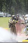 A member of the Marine Corps Air Station Beaufort fire department is washed as he goes through a decontamination center at the sight chemical spill at the training pool at Marine Corps Air Station Beaufort 130719-M-VR358-076.jpg