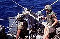 A member of the Marine detachment aboard the battleship USS MISSOURI (BB-63) prepares to fire a .50-caliber machine gun during exercise RIMPAC '87 - DPLA - c6307fe09d4e5fc1927074851eba59ae.jpeg