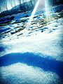A view of sunrays reflecting from snow.jpg