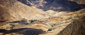 Laghman Province - A village sits in a valley in the Hindu Kush Mountain Range in Laghman Province