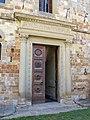 Abbazia di passignano, portale del xv sec del monastero 01.JPG