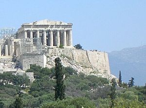 """The Parthenon of Athens seen from the hill of the Pnyx to the west. Location 23°43'35.69""""E 37°58'17.39""""N"""