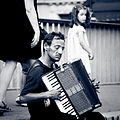 Accordionist on Pont Saint-Louis, Paris 2011.jpg
