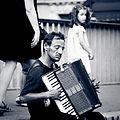 Accordionist on Pont Saint-Louis, Paris 2011.jpg