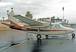 Flabob Airport - Based Aero Commander 500S in front of the Flabob control tower and hangars
