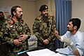 Afghan National Army officers visit a patient at the Kandahar Regional Medical Hospital Aug. 19, 2013, at Kandahar Airfield, Afghanistan 130819-A-VM825-074.jpg