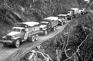 "Ledo Road - ""U.S.-built Army trucks wind along the side of the mountain over the Ledo supply road now open from India into Burma..."""