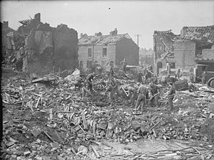Birkenhead - British troops of Western Command clearing up bomb damage in Birkenhead, 15 March 1941.