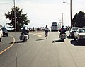 Al nearly at Mile Zero marker, Douglas St at Dallas Rd Victoria BC, motorcycle escort Sep 1 1991.jpg
