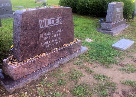 Gravesite of Laura Ingalls Wilder and husband Almanzo Wilder at Mansfield Cemetery, Mansfield, Missouri. Buried next to them is daughter Rose Wilder Lane. Almanzo and Laura Wilder gravesite Mansfield MO.jpg