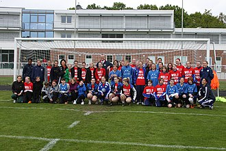 Phil Murphy - A soccer enthusiast, Ambassador Murphy poses with girls school teams in Lower Saxony in 2011. Former U. S. national team players Briana Scurry and Amanda Cronwell are also present.