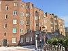foto van Bouwblok van 96 etagewoningen, gebouwd door Bouwvereeniging Rochdale, blok f fase 1,