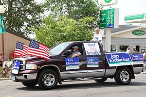 Amy Klobuchar - Amy Klobuchar's father, Jim, and supporters campaigning for Klobuchar as U.S. Senator, Tower, Minnesota, July 4, 2012