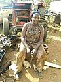 An african lady working at a garage. She is a mechanic.jpg