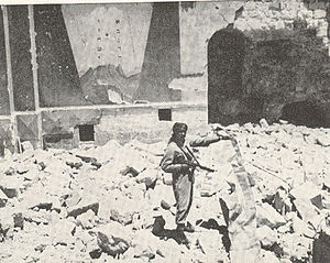Islamization of Jerusalem - An Arab Legion soldier in ruins of Hurva Synagogue.