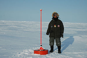 Metocean - Ice beacon – for tracking the movement of the ice by GPS, as well as containing other sensors for measuring more metocean parameters – and Pablo Clemente-Colón of the U.S. National Ice Center.
