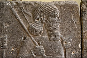 Mace (bludgeon) - Assyrian soldier holding a mace and a bow. Detail of a basalt relief from the palace of Tiglath-pileser III at Hadatu, Syria. 744-727 BCE. Ancient Orient Museum, Istanbul