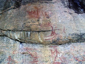 Culture of Finland - Prehistoric red ochre painted rock art of moose, human figures, and boats in Astuvansalmi, Finland from ca. 3800–2200 BC.