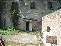 At the main entrance of former Stara Gradiska Prison.jpg