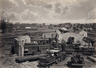 Photographers of the American Civil War - Ruined roundhouse in Atlanta, Georgia after the Atlanta Campaign. Albumen print by George Barnard, 1866. Digitally restored. A distinctive attribute of Barnard's work was to superimpose clouds into an otherwise overexposed sky.