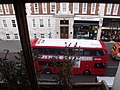 Baker Street, London - opposite The Sherlock Holmes Museum - Red London bus (6432736439).jpg
