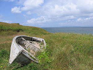 Isle Madame (Nova Scotia) - Coastline with derelict dory