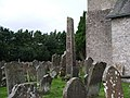 Bewcastle - the churchyard at St Cuthbert's, with the 7thC Cross - geograph.org.uk - 958570.jpg
