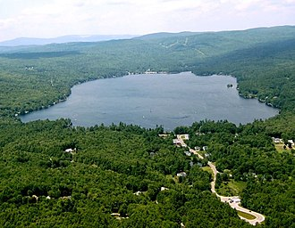 Pleasant Lake (New London, New Hampshire) - Aerial view of Pleasant Lake with village of Elkins in foreground
