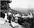 Black & white print; scene; Ranger, woman & 2 boys look out at Army-Navy Hospital and southeast Hot Springs from West Mountain (a734604a-e674-4989-9f46-fa20af53fee7).jpg