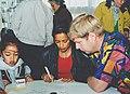 Black woman teaching calligraphy.jpg
