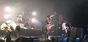 "A Weekend in the City - Bloc Party before the performance of ""I Still Remember"" in Sydney on 4 August 2007; Okereke often opted to use a Gretsch Tennessee Rose guitar, which creates a softer sound, in the studio and in concert"