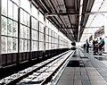 Blurry railway platform (Unsplash).jpg