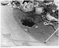 Bomb hole through upper deck, USS California - NARA - 296949.tif