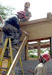 Bond beam work at Gabriela Mistral School construction site 150622-F-LP903-871.jpg
