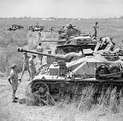 British troops inspect a line-up of captured German and Italian armoured fighting vehicles, Italy, 2 June 1944. NA15779
