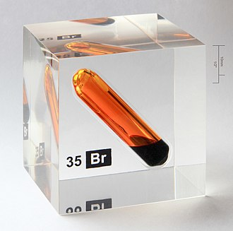 Poly(methyl methacrylate) - Illustrative and secure bromine chemical sample used for teaching. The glass sample vial of the corrosive and poisonous liquid has been cast into an acrylic plastic cube